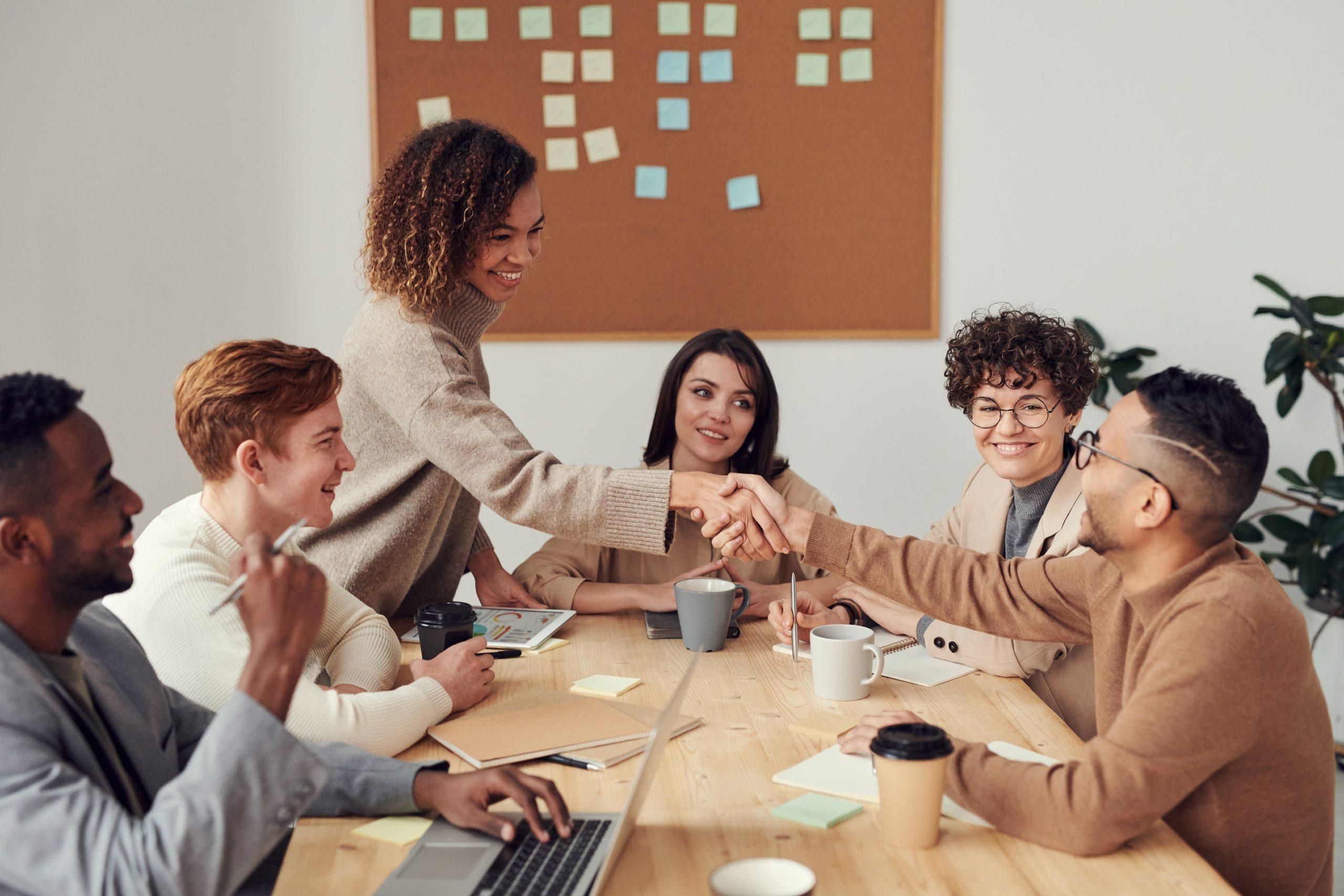 happy customers shake hands satisfaction